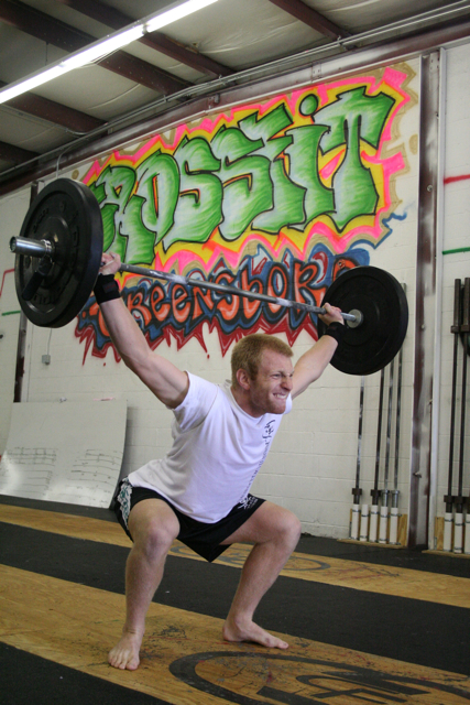 Crawford snatching during a workout at CrossFit Greensboro.